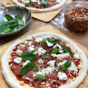 An image of a pizza being made by a bakery student in Bread Ahead's pizza making course