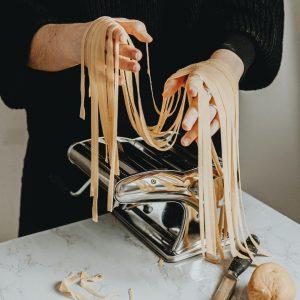 A bread ahead baking school student making fresh pasta.